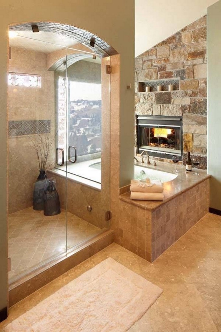 15 Luxury Bathrooms with Astonishing Fireplaces. To see more Luxury Bathroom ideas visit us at www.luxurybathrooms.eu #luxurybathrooms #homedecorideas #bathroomideas @BathroomsLuxury 15 luxury bathrooms with astonishing fireplaces 15 Luxury Bathrooms with Astonishing Fireplaces 15 luxury bathrooms with fireplaces 14